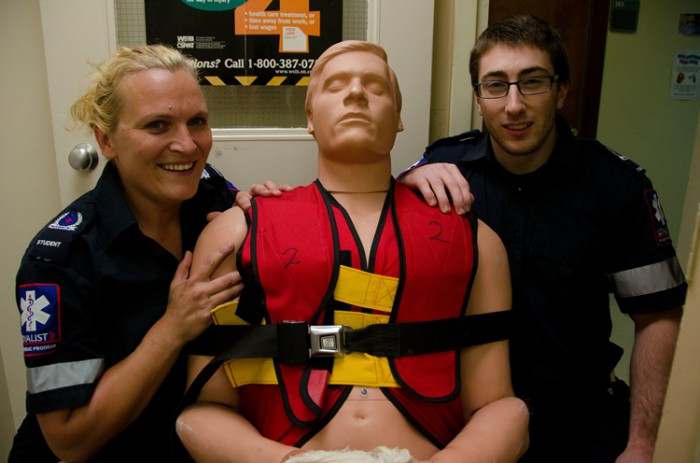Melissa Weaver and Marcus Pearson pose with Fred the test dummy