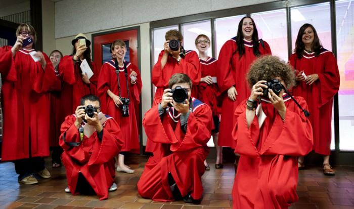 Graduates pose with their cameras at Convocation