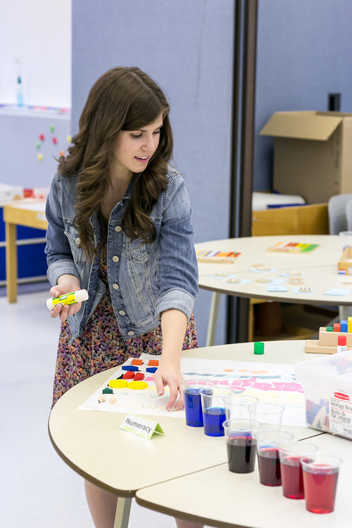 Megan Palmer sets up a shapes activity station in the ECE classroom