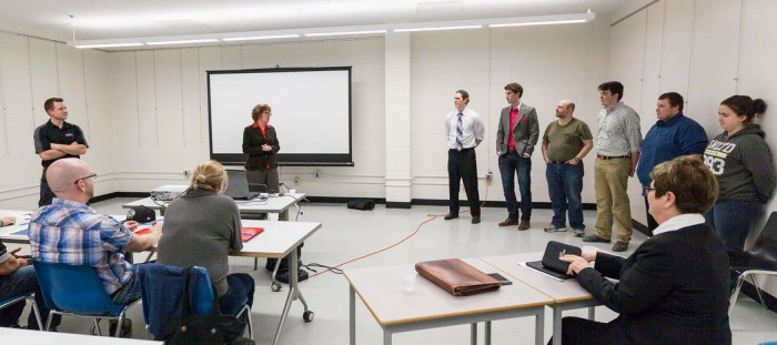 Loyalist College President Maureen Piercy speaks to student presenters on Apr. 20.