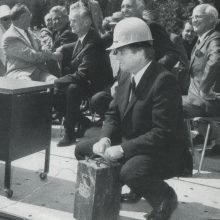 William G. Davis pushing the plunger at the sod-blasting ceremony to start the construction of the permanent building.
