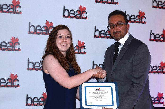 Jessica Baldwin, a second-year Loyalist College Broadcasting - Radio student was presented with the Broadcast Educators Association of Canada's (BEAC) President's Award in the audio category by BEAC Board of Directors President/Western Director Ashif Jivraj, BCIT. Photo credit - Brian Nuttall, Broadcast Educators Association of Canada