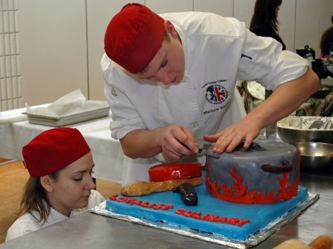 Loyalist second year students decorate cake.
