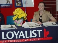Chantel Dilts from Loyalist Recruitment welcomes guests to the Open House.