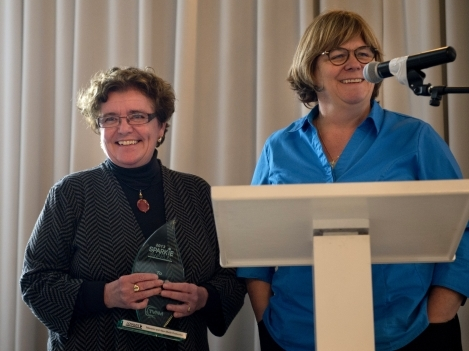 Professor Cathy Goddard, right, presents Jane Harrison, Dean of the School of Media,  Arts and Design, with the Program Support Award.